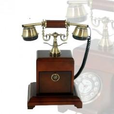 Teléfono antiguo de madera giratorio con detalles en oro viejo