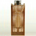 Portavelas fabricado en mimbre con detalles de madera