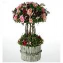 Centro de flores artificiales en tonos rosas