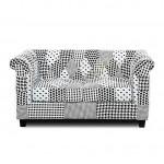Sofá dos plazas estilo retro tapizado patchwork blanco y negro