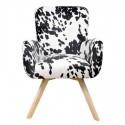 Sillón animal print con tapizado textil blanco y negro y patas en madera