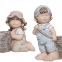 Figuras decorativas niños con cestos florero