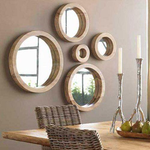Espejos en mosaico para decorar paredes con estilo moderno. Los espejos que forman mosaicos son la ultima tendencia en decoración.