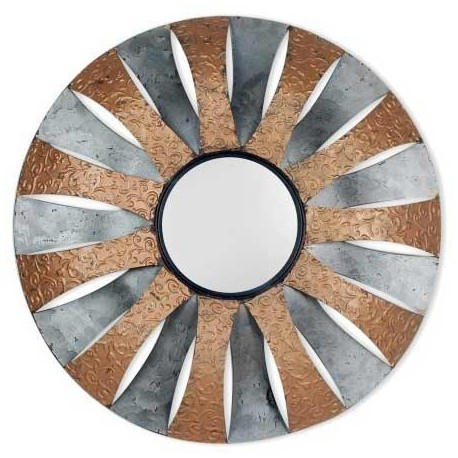 Espejos decorativos redondos y con relieves en dos tonos: marron y plata. Este espejo quedará muy bien en tu aparador junto con otros espejos circulares